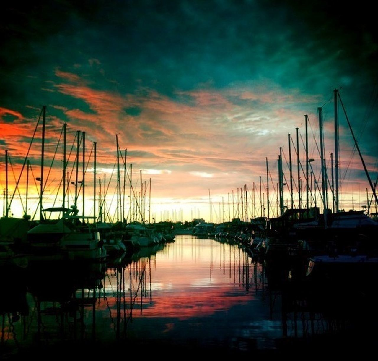 nautical vessel, sunset, reflection, moored, water, transportation, sky, cloud - sky, harbor, mast, no people, outdoors, tranquility, travel destinations, tranquil scene, nature, sea, sailboat, scenics, beauty in nature, sailing ship, day