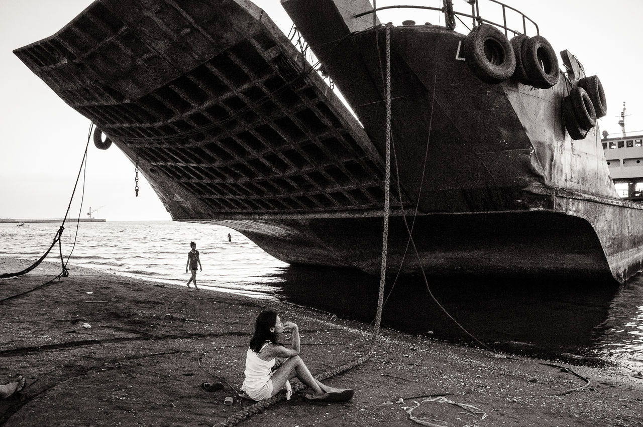Chillin under the boat. Shot while on an afternoon stroll in Cavite. Beach Black And White Cavite Leisure Activity Lifestyles Monochrome Outdoors Philippines Seaside Shore Tanza Water