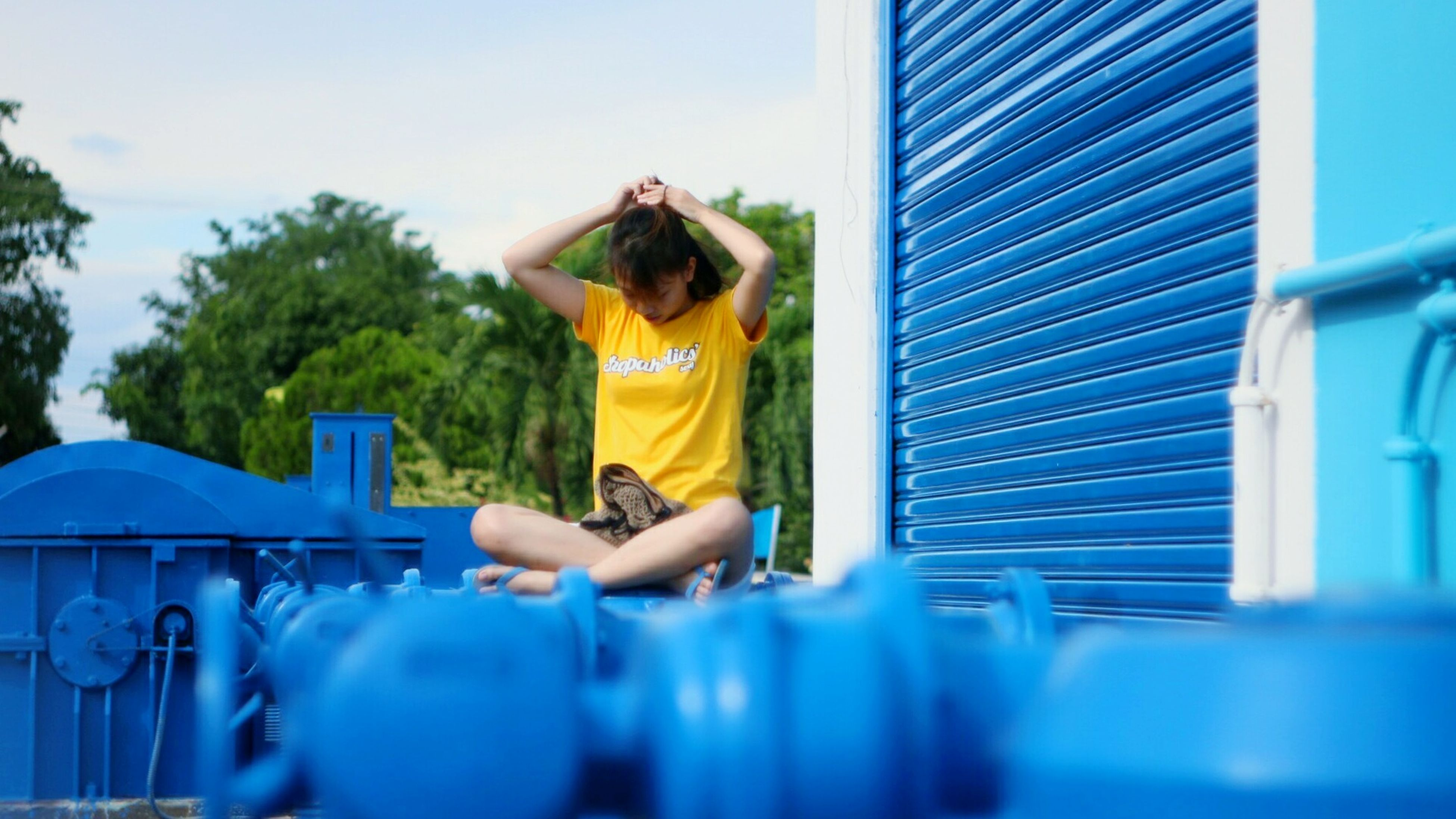 blue, lifestyles, leisure activity, sky, day, part of, cropped, outdoors, casual clothing, focus on foreground