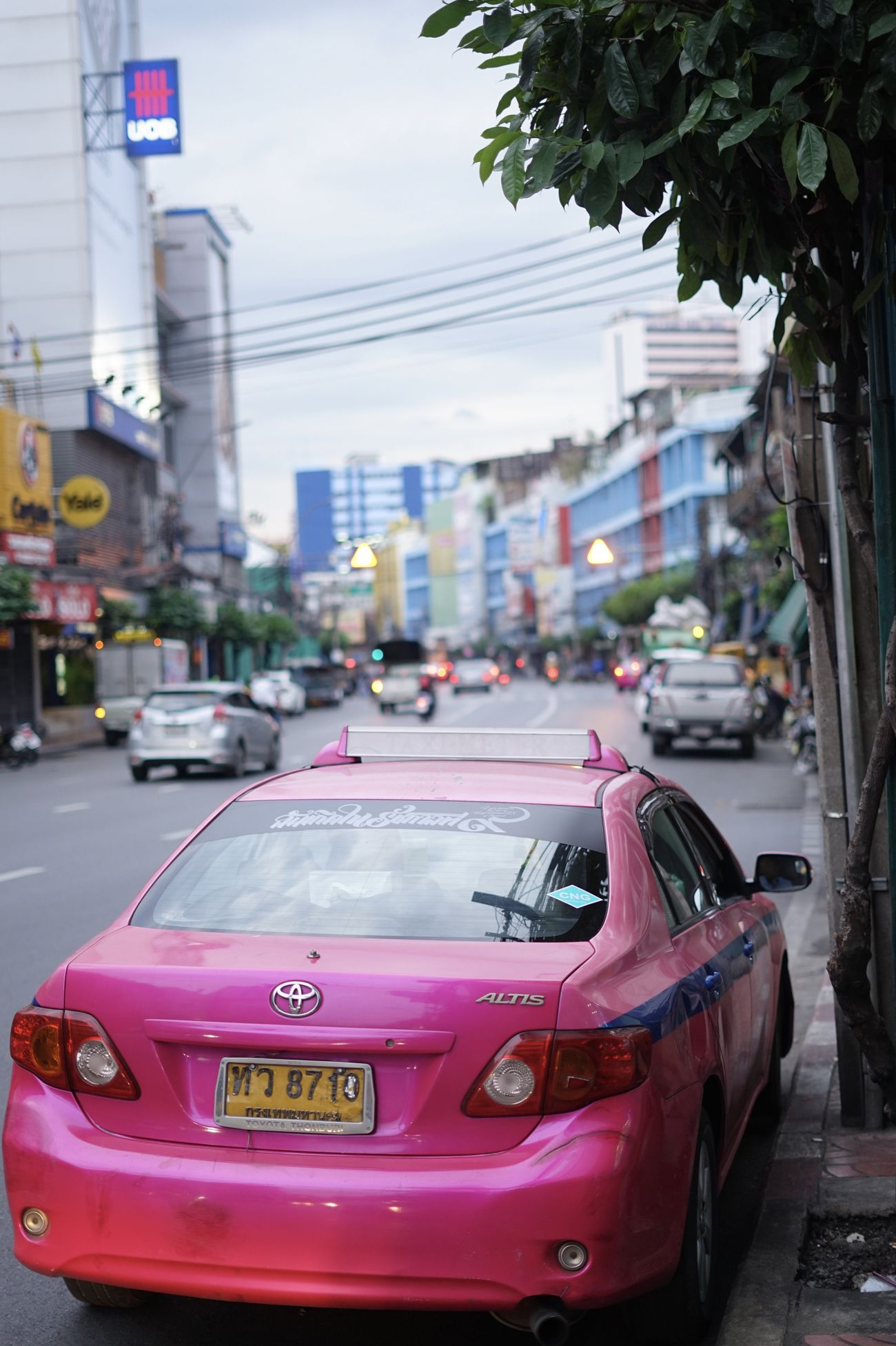 Bangkok symbolic pink taxi Architecture Bangkok Building Exterior Built Structure Car City City Break City Life City Street Day Mode Of Transport No People Outdoors Pink Pink Color Street Taxi Taxi Thailand Traffic Transportation Travel Travel Destinations Vehicle Mirror Yellow Taxi