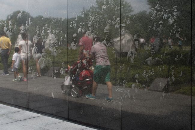 City Life Memorial Mirroring Past And Present Polished Stone Wall Tourist Attraction  Tourists War