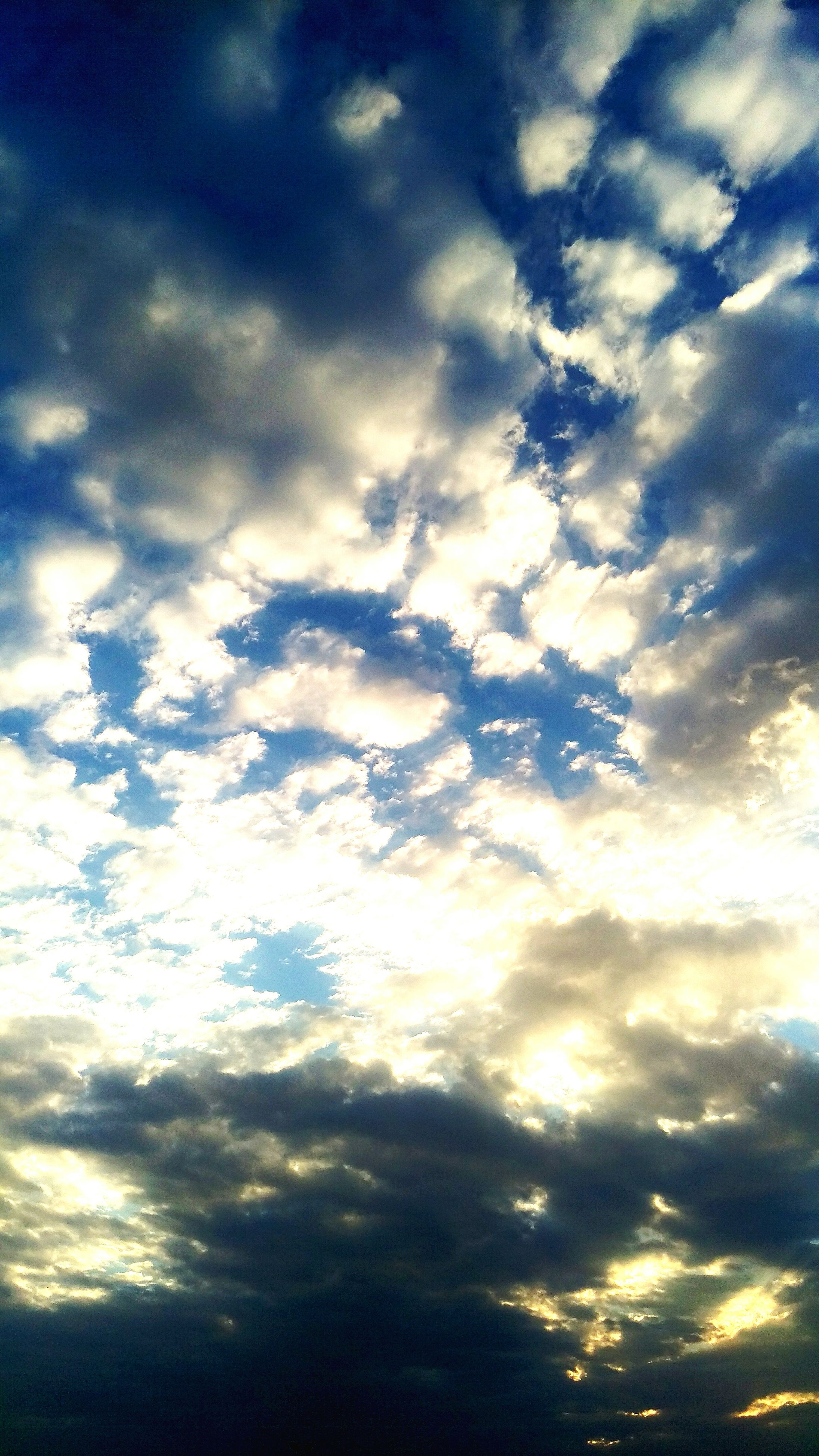 scenics, sky, low angle view, beauty in nature, tranquility, tranquil scene, cloud - sky, majestic, cloud, cloudscape, idyllic, nature, sunbeam, blue, sky only, atmospheric mood, environment, cloudy, meteorology, day, heaven, outdoors, atmosphere, dramatic sky, sun, full frame, moody sky, bright, fluffy, cumulus cloud, ethereal, back lit