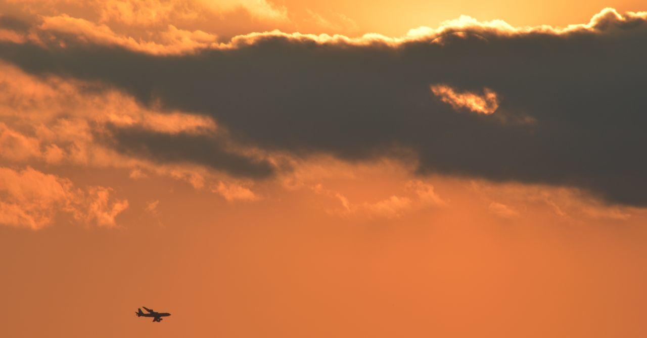Silhouette Airplane In Orange Sky