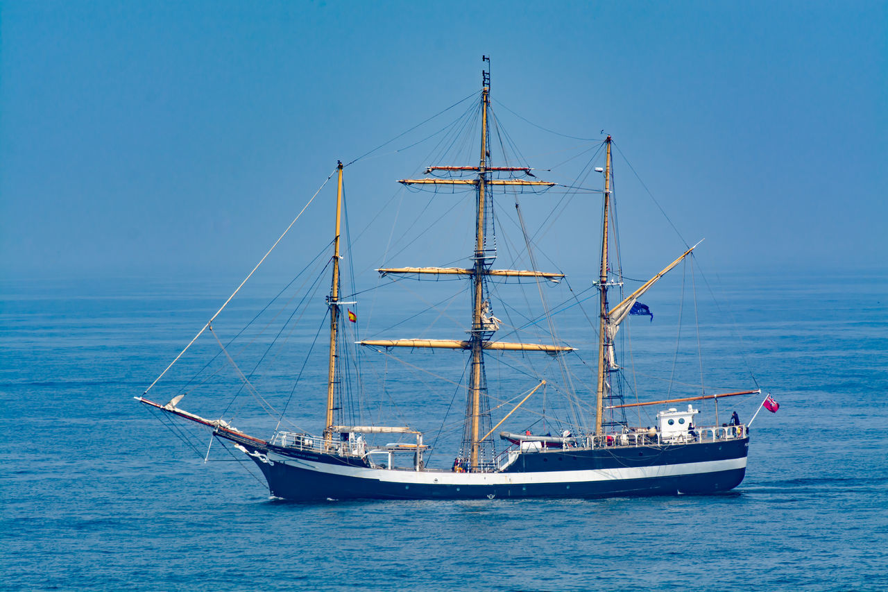 nautical vessel, transportation, sea, mode of transport, boat, water, blue, mast, no people, nature, outdoors, waterfront, day, horizon over water, moored, sky, beauty in nature, sailing, clear sky, sailing ship