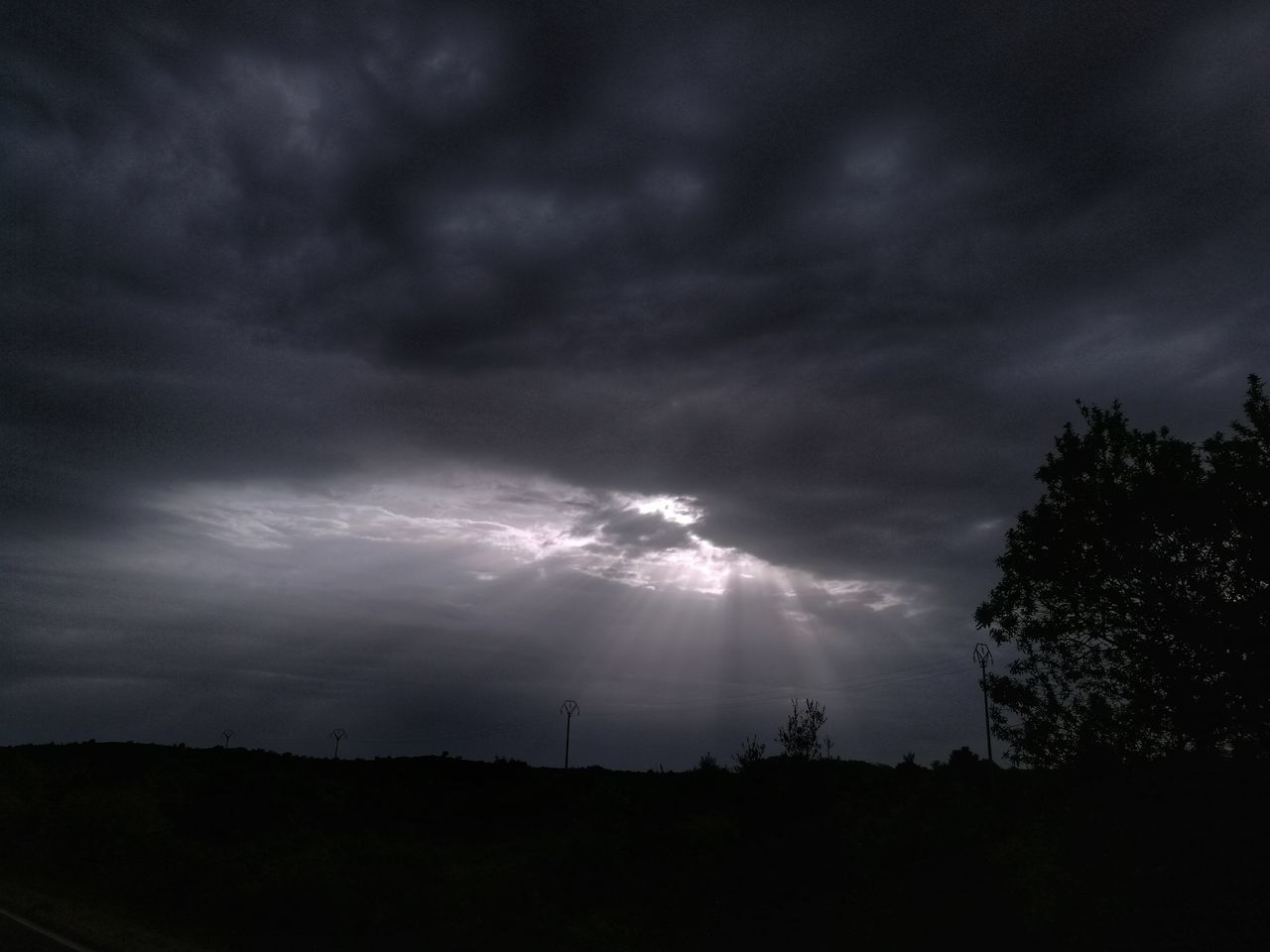 sky, cloud - sky, nature, beauty in nature, silhouette, storm cloud, weather, dramatic sky, tree, scenics, no people, storm, thunderstorm, outdoors, lightning, power in nature, landscape, low angle view, night, forked lightning