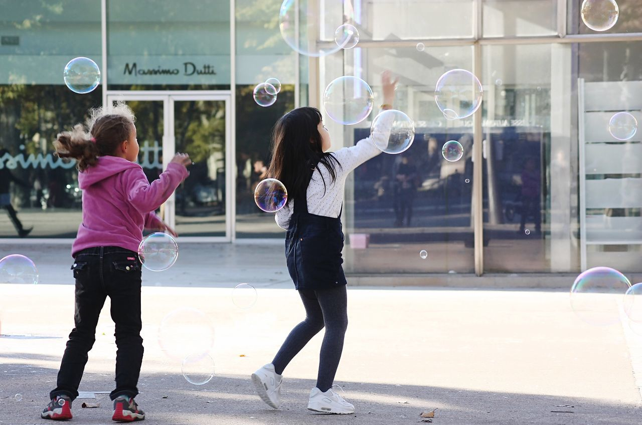 Enjoy The New Normal Friendship Children Outdoors People Street Streetart Game Bubbles Girls Aixenprovence