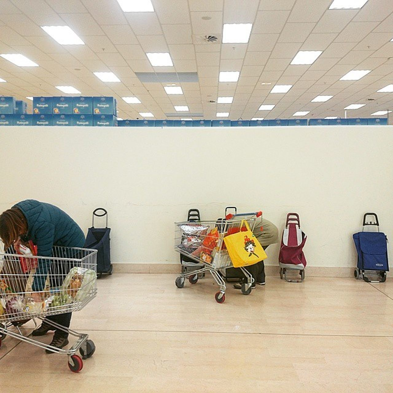 indoors, trolley, shopping cart, consumerism, real people, full length, men, supermarket, one person, day, people