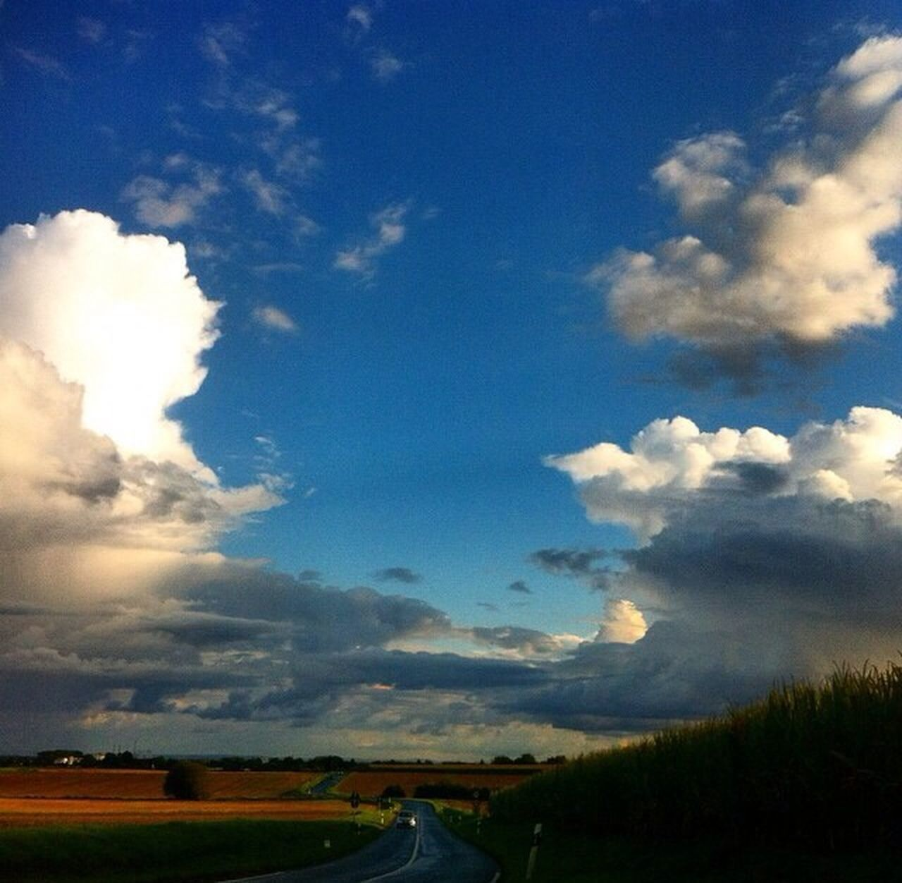 cloud - sky, sky, no people, architecture, built structure, landscape, field, blue, nature, beauty in nature, outdoors, day, scenics, building exterior, tree