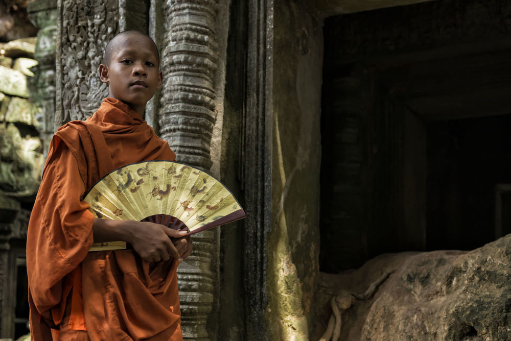 The Golden Fan Art Is Everywhere ASIA Asian Culture Buddhism Buddhist Buddhist Monk Buddhist Temple Cambodia Cultures EyeEm Best Shots EyeEm Diversity Fan Monk  Outdoors Religion Spirituality Ta Prohm The Secret Spaces Travel Destinations Travel Photography TCPM The Portraitist - 2017 EyeEm Awards Place Of Heart
