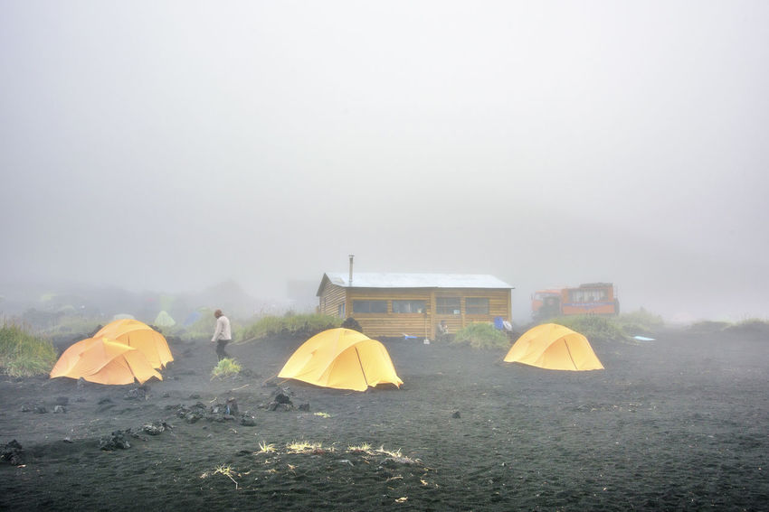 Adventure basecamp at Kamchatka Adventure Camping Day Far East Fog Kamchatka Landscape Mountain Nature Outdoors People Recreational Pursuit Russia Scenics Sky Vacations
