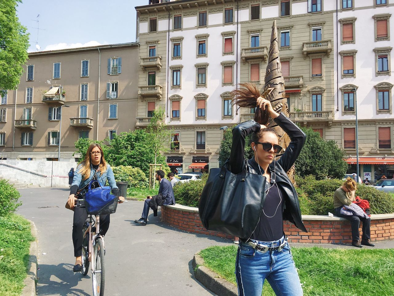 young women, young adult, bicycle, carefree, city, arts culture and entertainment, adult, people, adults only, city life, outdoors, real people, women, day, togetherness, architecture