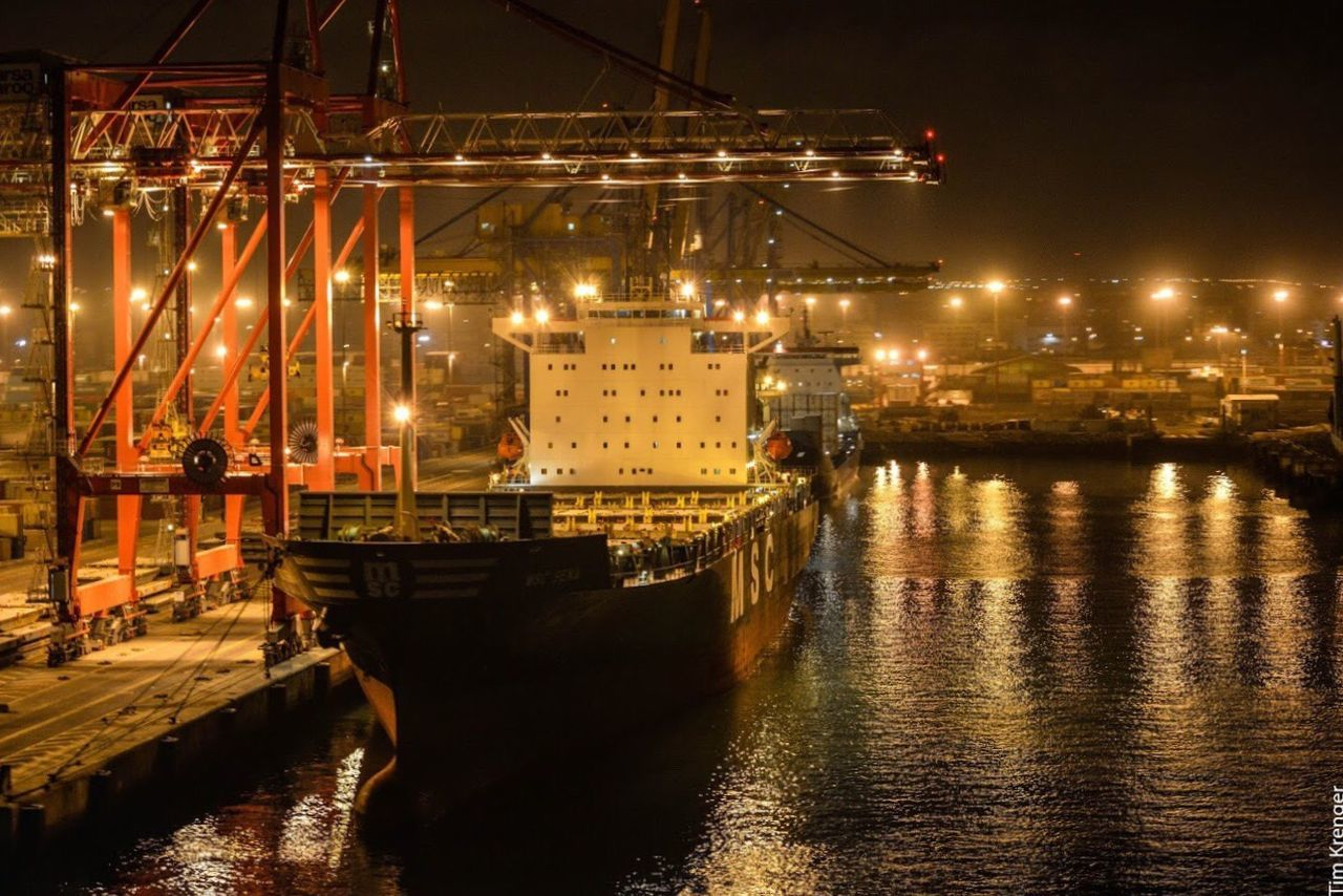 night, illuminated, waterfront, water, reflection, transportation, no people, river, nautical vessel, freight transportation, mode of transport, built structure, architecture, outdoors, commercial dock, industry, building exterior, harbor, city, sky