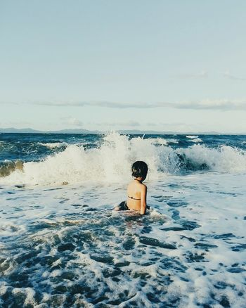 Face your fear One Person Sea Only Women Horizon Over Water One Woman Only Beach People Sky Adult Mid Adult Summer Rear View Water Adults Only Women Outdoors Day Vacations Tranquility Wave The Great Outdoors - 2017 EyeEm Awards