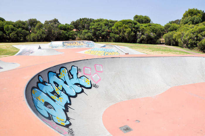 Spearwood Skate Park with concrete bowl and ramps with urban murals and tagging in Western Australia. Bowl Colorful Concrete Day Expression Graffiti Greenery Mural No People Outdoors Playground Rails Ramps Recreation  Skateboard Park Skatepark Spearwood Sport Sports Tagging Tree Venue Visual Statements Western Australia Youth Culture