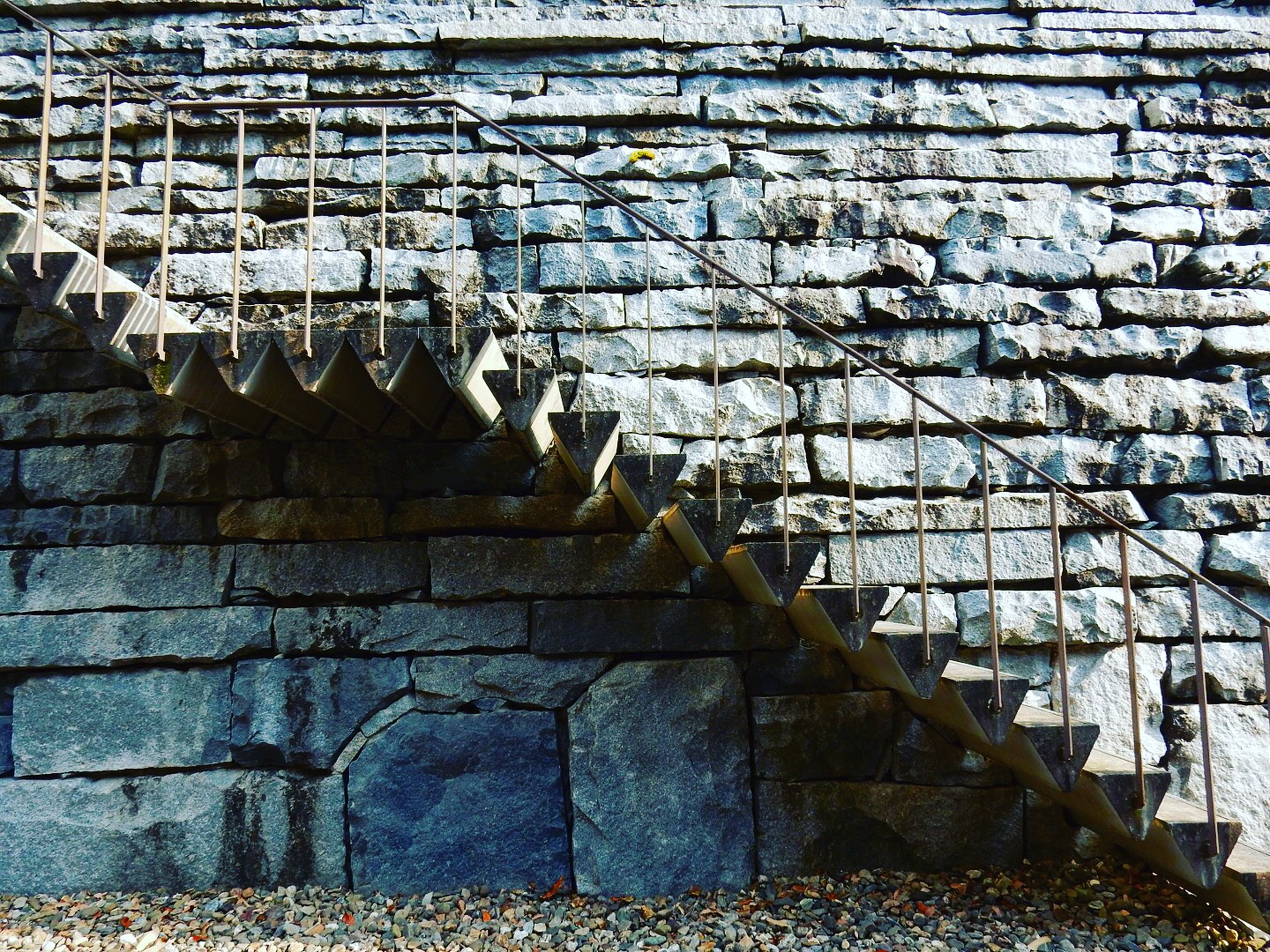 architecture, built structure, building exterior, brick wall, wall - building feature, old, stone wall, history, building, day, low angle view, pattern, outdoors, no people, steps, damaged, wall, weathered, metal, sunlight