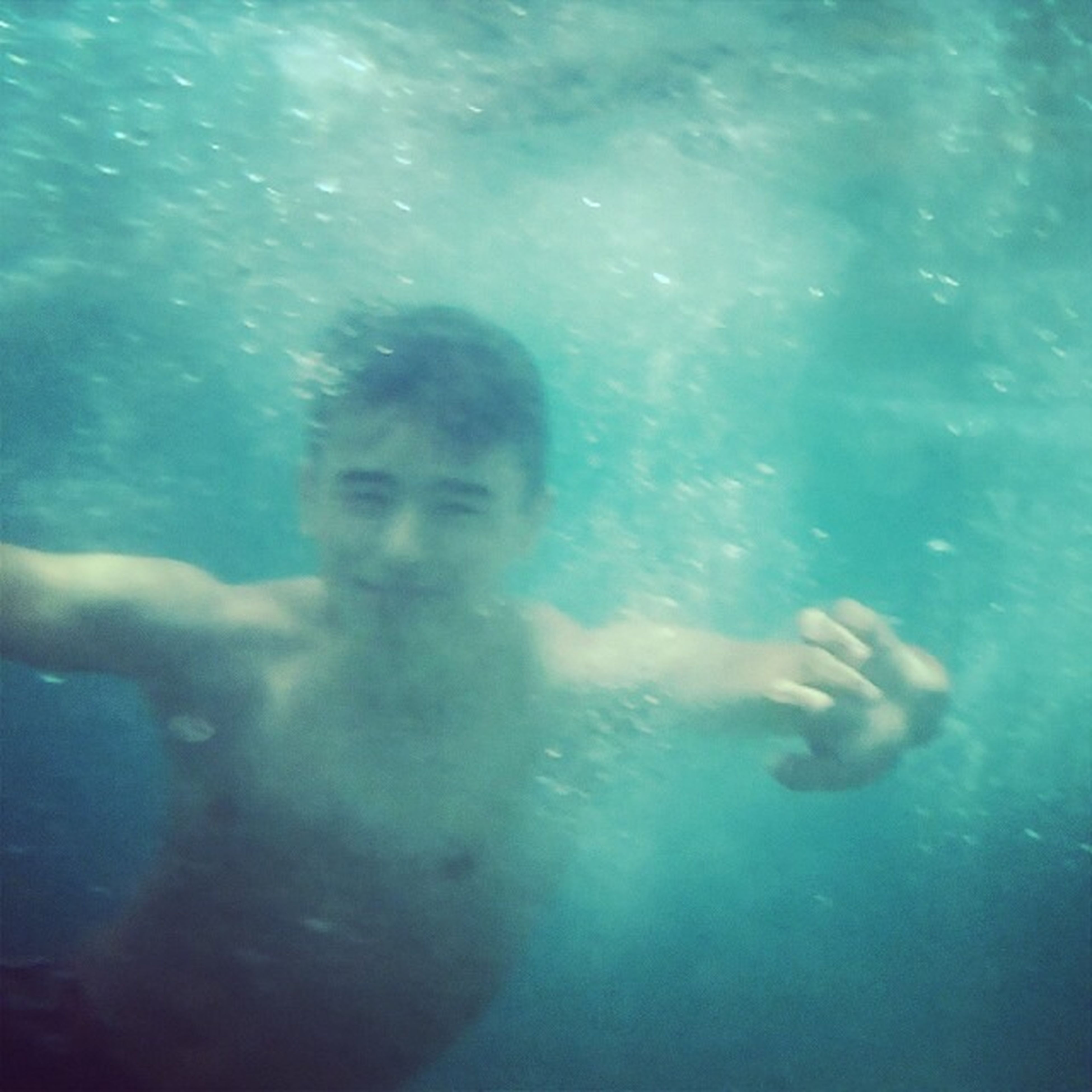 water, swimming, underwater, leisure activity, lifestyles, swimming pool, sea, undersea, blue, high angle view, men, shirtless, fish, turquoise colored, full length, transparent, sea life, enjoyment