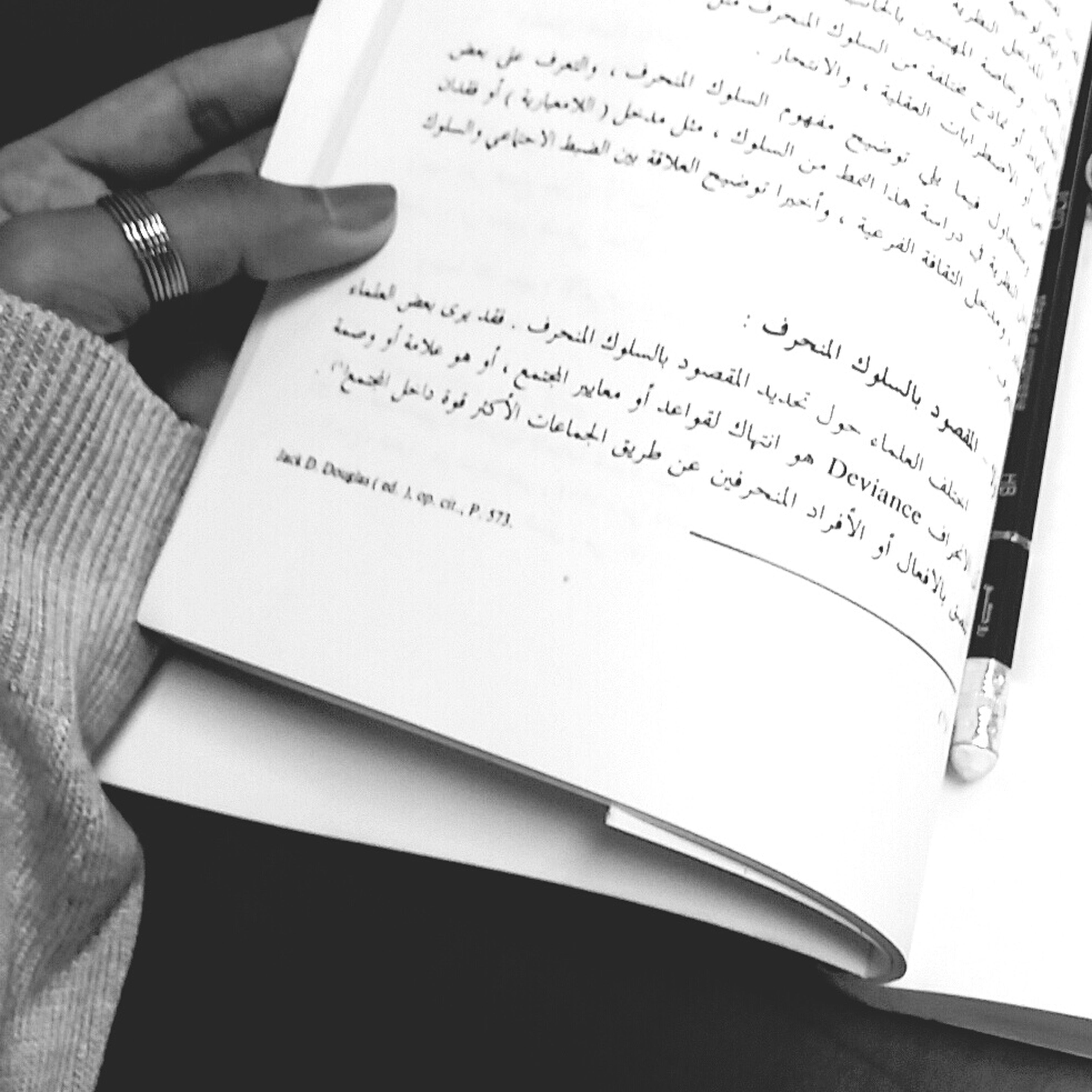 indoors, person, book, part of, cropped, paper, text, human finger, communication, holding, education, close-up, pen, western script, table, unrecognizable person, writing