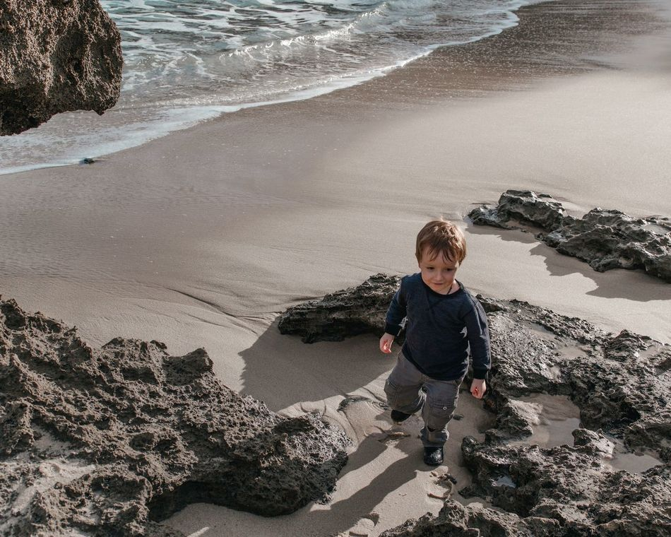 little one on a beach in Sorrento Beach Sand Sea Childhood Child Boys Vacations Water Shore One Boy Only Children Only One Person Shadow Sunlight Summer Day Outdoors Individuality The Secret Spaces Beautiful People EyeEm Diversity Sorrento Victoria Melbourne Beach Photography Australia