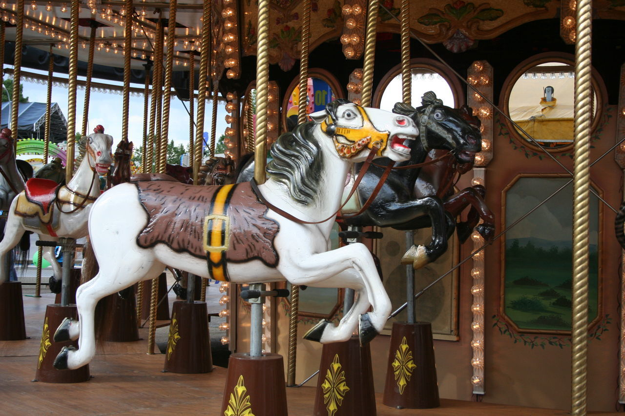 horse, animal representation, amusement park, carousel horses, carousel, arts culture and entertainment, amusement park ride, animal themes, no people, day, merry-go-round, outdoors