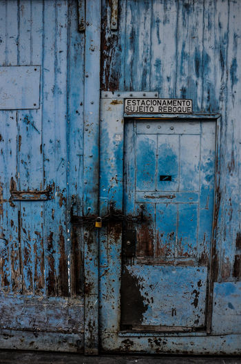 Architecture Backgrounds Blue Close-up Communication Day Door No People Outdoors Text Weathered Wood - Material
