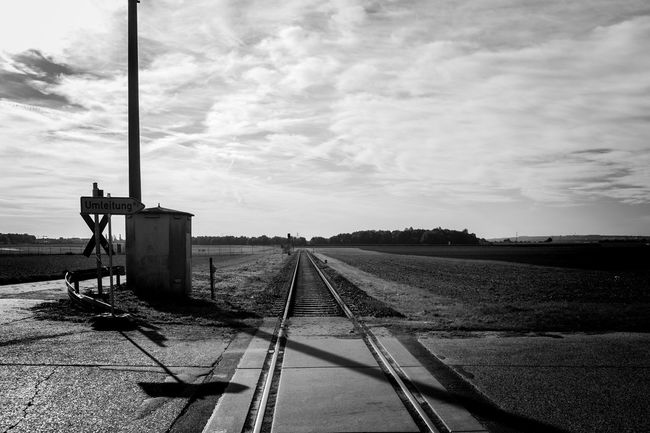 Railway Crossing Absence Black And White Cloud Cloud - Sky Cloudy Diminishing Perspective Endless Horizon Light Outdoors Public Transportation Rail Transportation Railroad Track Railway Crossing Railway Track Shadow Sky The Way Forward Tracks Transition Transportation Travel Travel Lust Vanishing Point Wanderlust