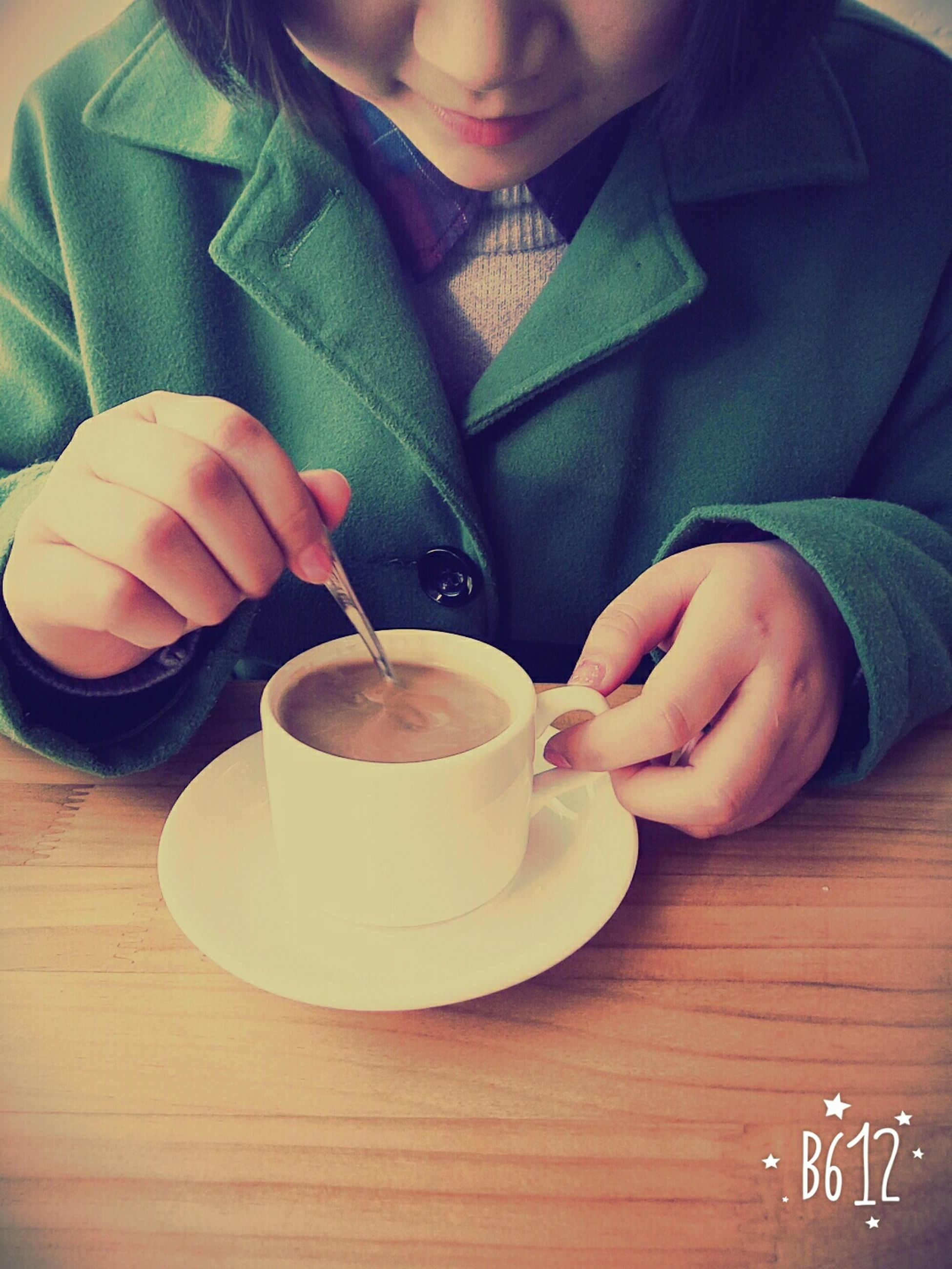 food and drink, drink, indoors, refreshment, table, person, coffee cup, holding, freshness, lifestyles, coffee - drink, leisure activity, food, coffee, cup, close-up, men