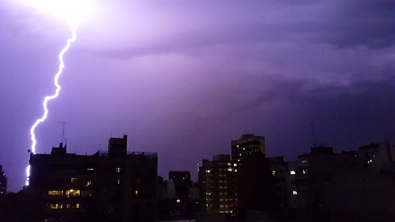 lightning, illuminated, night, thunderstorm, weather, forked lightning, built structure, building exterior, power in nature, danger, city, storm, architecture, sky, storm cloud, no people, outdoors, cloud - sky, cityscape, silhouette, nature, skyscraper, urban skyline