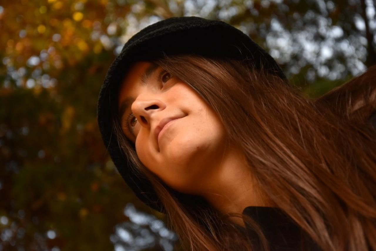 Hat Head And Shoulders Lifestyles Long Hair Model Model Pose Natural Beauty Portrait Real People Selective Focus Smiling Trees #leaves Sunlight Warm Color [ Young Women