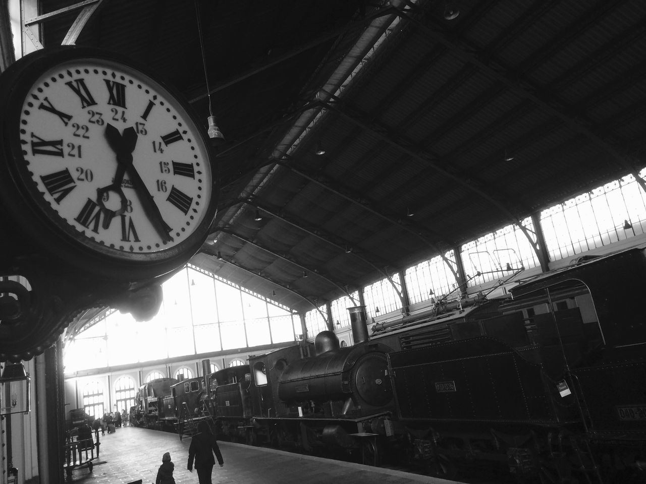 clock, time, rail transportation, public transportation, transportation, railroad station, train - vehicle, railroad station platform, low angle view, indoors, mode of transport, real people, men, day, clock face, minute hand, people