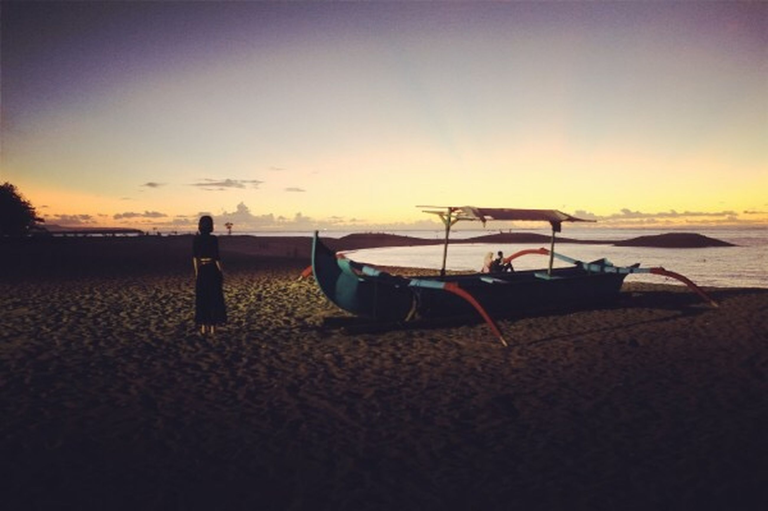 sunset, beach, sand, sky, transportation, copy space, shore, orange color, tranquility, sea, tranquil scene, mode of transport, scenics, beauty in nature, nature, clear sky, silhouette, horizon over water, outdoors, dusk