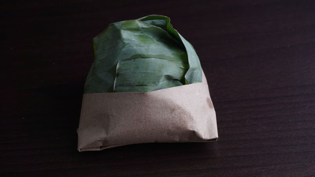 nasi lemak is a Malaysian traditional food, eaten during breakfast, prepared with a variety of side dishes. Banana Leaves Breakfast Favorite Flavor Flavors Fried Chicken Fried Egg Malaysia Melayu Nasi Lemak Sambalbelacan Tradisionalfood Wrap