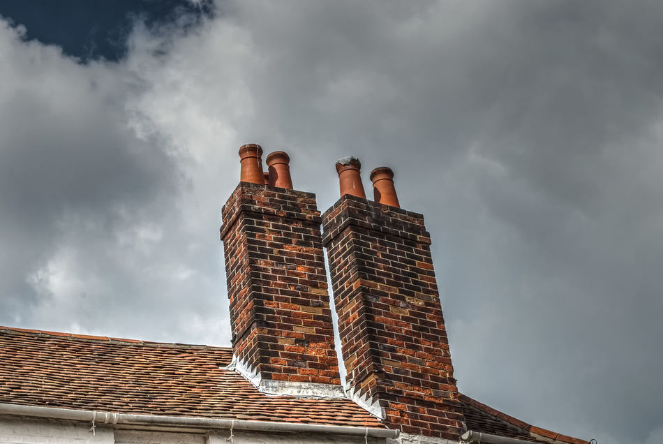 Old chimney. Architecture Built Structure Building Exterior Tall - High Cloud Architectural Feature Chimney Bricks Chimney Pots Chimneys Chimney Pot