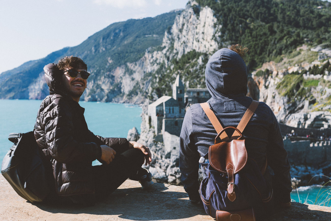 Beauty In Nature Casual Clothing Day Italy Landscape Leisure Activity Lifestyles Men Mountain Mountain Range Nature Outdoor Photography Outdoors Real People Relaxation Sitting Sky Sunlight Togetherness Travel Travel Destinations Two People Young Men
