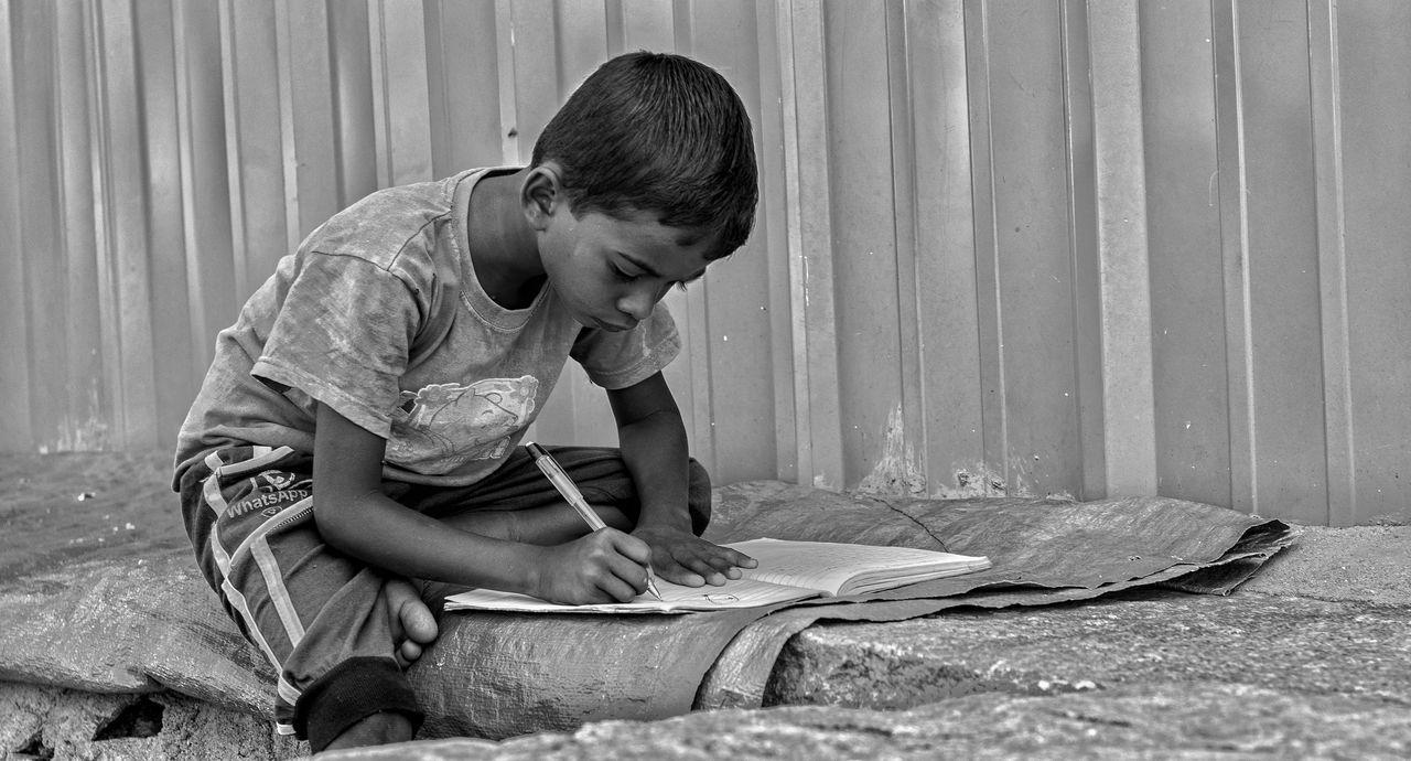 Day People Streetphotography Hampi  Karnataka Travel India Outdoors Life Real People Black And White Monochrome Street Realpeople Childhood Kid Lifestyles Student Learn Write Read EyeEm Best Shots Eyem Gallery EyeEmBestPics EyeEm Best Shots - The Streets