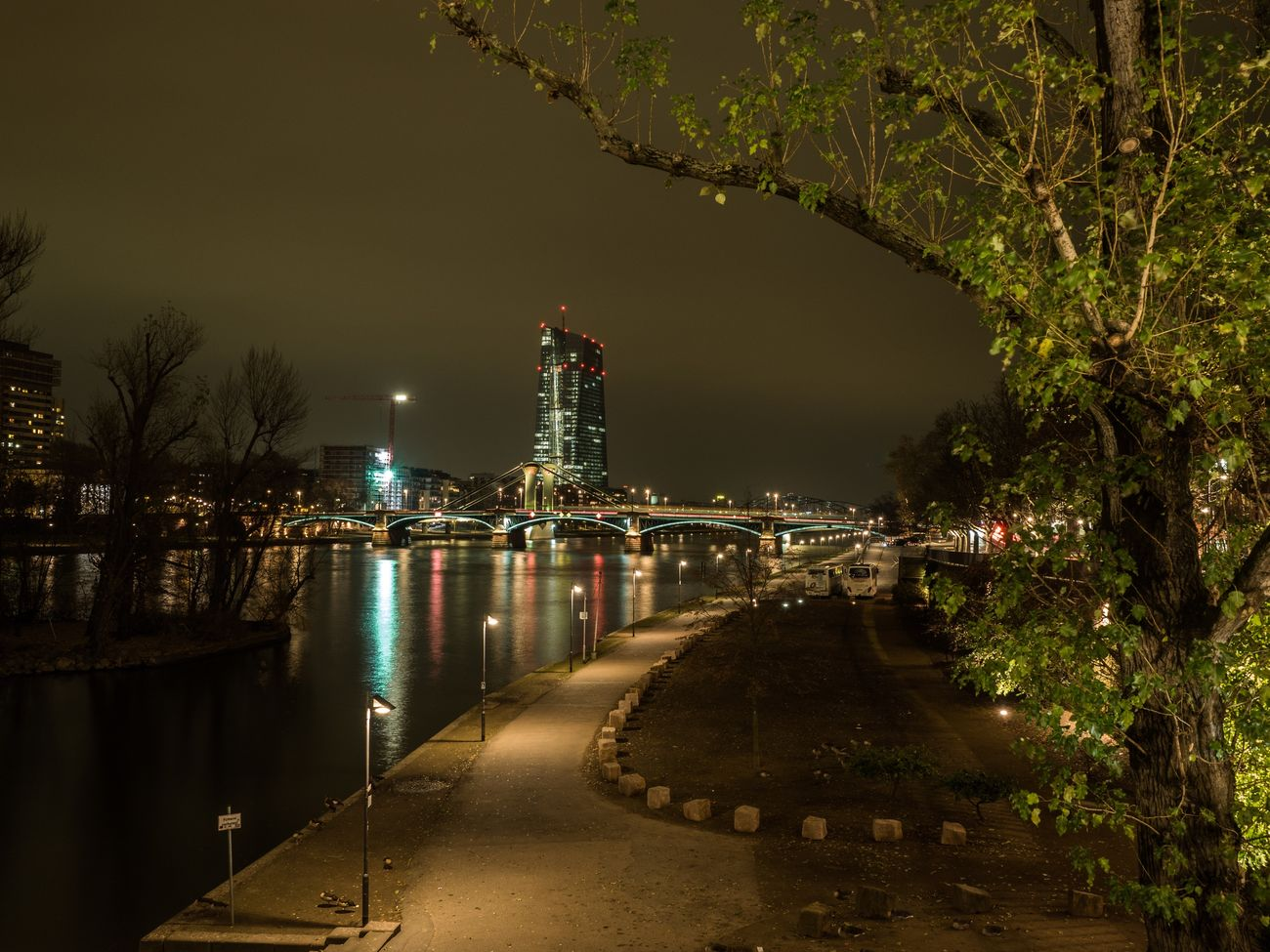 A different perspective onto the ECB. Night Illuminated Architecture The Way Forward Tree City Travel Destinations Outdoors No People Water Sky Nature Frankfurt Main River Bridge Lights Urban Reflection