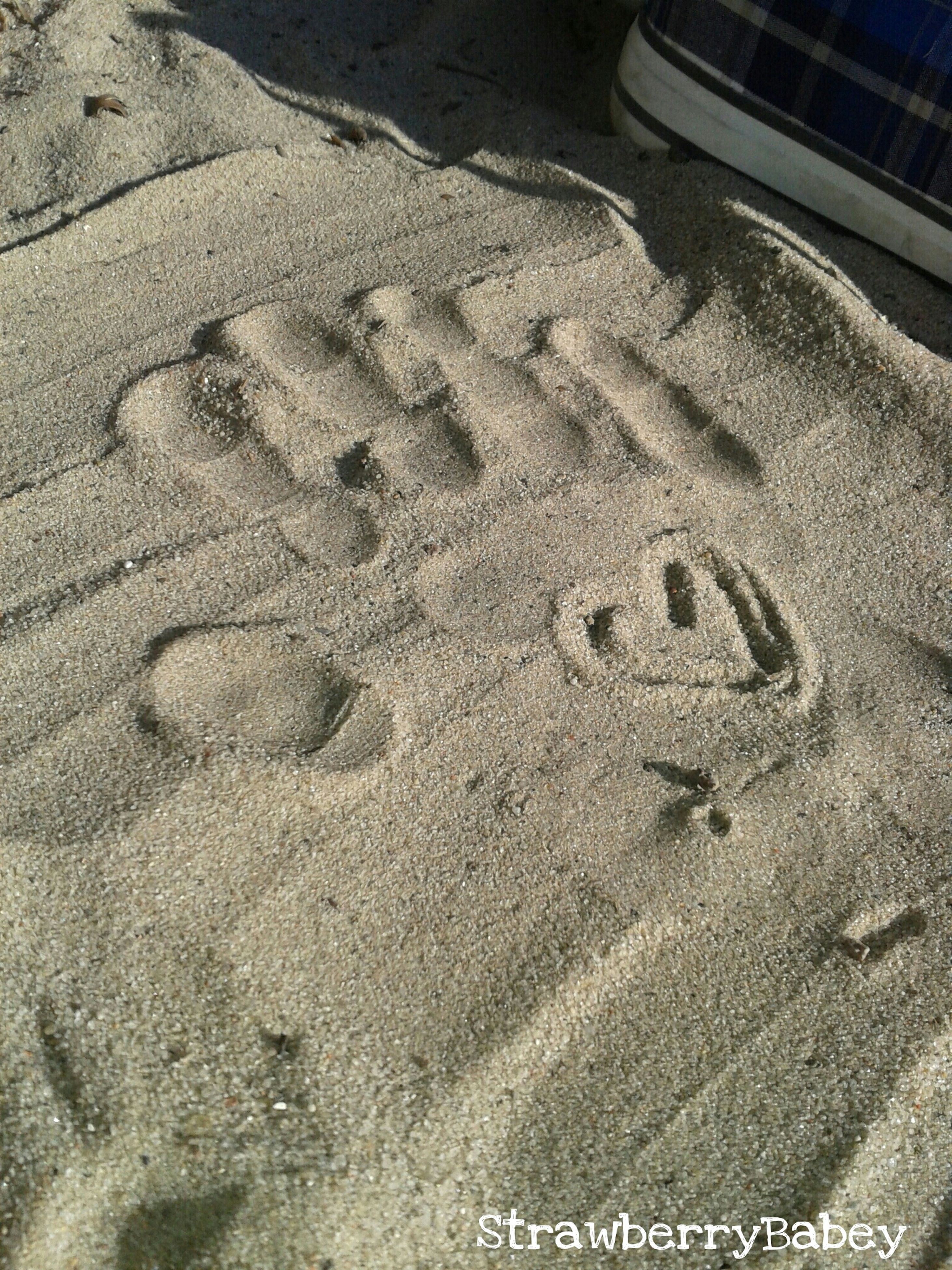 high angle view, sand, text, landscape, communication, beach, day, aerial view, no people, western script, outdoors, full frame, nature, tranquility, footprint, textured, backgrounds, road, pattern, transportation