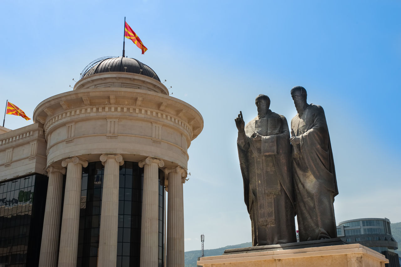 Statue of Cyril and Methodius beside the Macedonian Archeological Museum in Skopje, Macedonia (FYROM) Architectural Column Architecture Building Exterior Built Structure City Clear Sky Cyril And Methodius Day Flag Macedonia No People Outdoors Sculpture Sky Statue Travel Travel Destinations