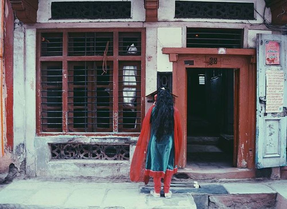 I didn't know old red public telephones still exit. . Girl Red Telephone Public Streetphotography _soi @streets.of.india Soiwalks Strolls Streetphotographyindia @streetphotographyindia India Colors Sonalishelar