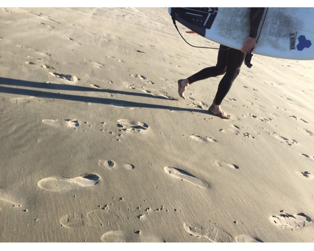 low section, real people, human leg, sand, one person, walking, beach, day, leisure activity, outdoors, lifestyles, human body part, shadow, sunlight, men, women, skill, nature, adult, people