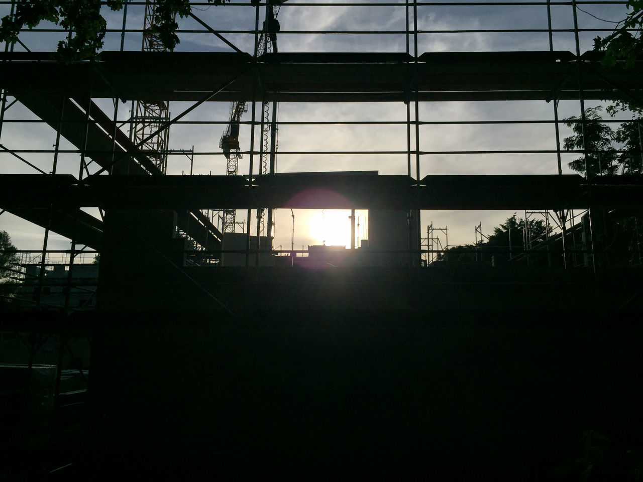construction area in the evening Building Lot Building Site Building Yard Construction Area Construction Site Eve Evening Evening Light Evening Sky Evening Sun Evening Sunset Falsework Field No People Scaffold Scaffolding Silhouette Site Sky Sky And Clouds Sun Sunlight Sunset