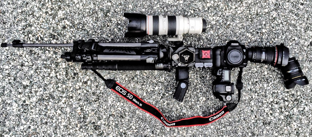 Assaultrifle made up of DSLR camera parts laid out on the road. Camera Assaultrifle Rifle Riffle DSLR Dslr Camera Canon Gun Automatic Semi Semi-automatic Weapon Gun No People Close-up Outdoors Day Layout Laid Out Road Tarmac Tripod Lens Concept Conceptual Photography