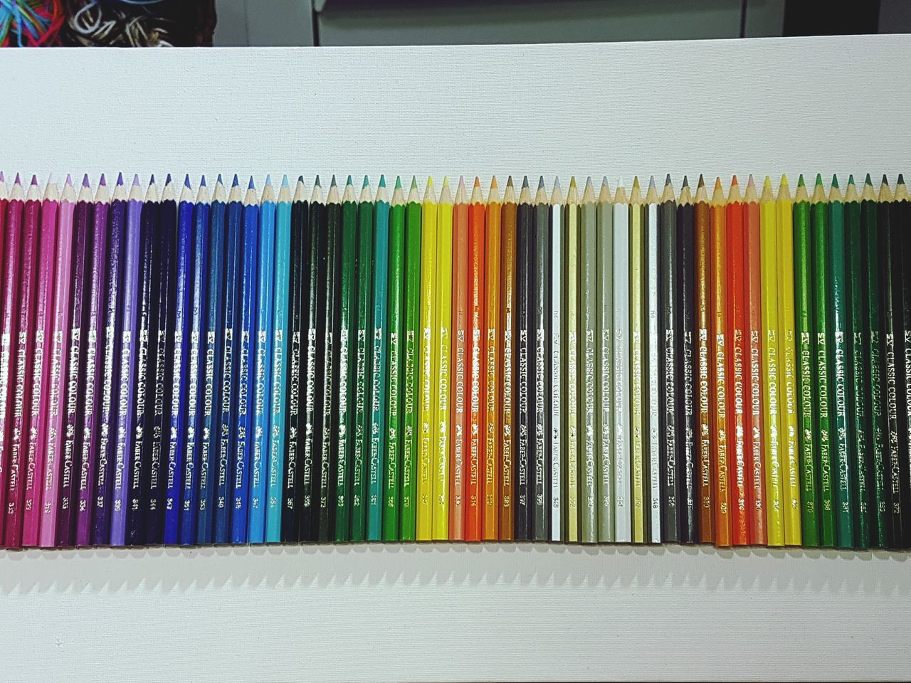 High Angle View Of Colored Pencils Arranged On Table
