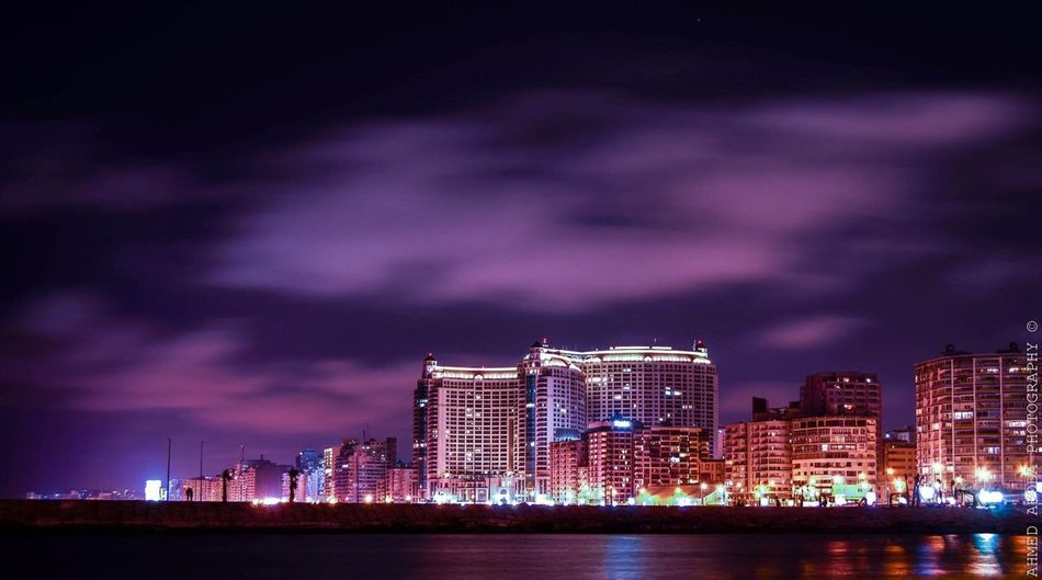Illuminated Night City Architecture Sky Building Exterior Urban Skyline Built Structure Cloud - Sky No People Outdoors Cityscape Skyscraper Storm Cloud Water Lightning Nature Egypt