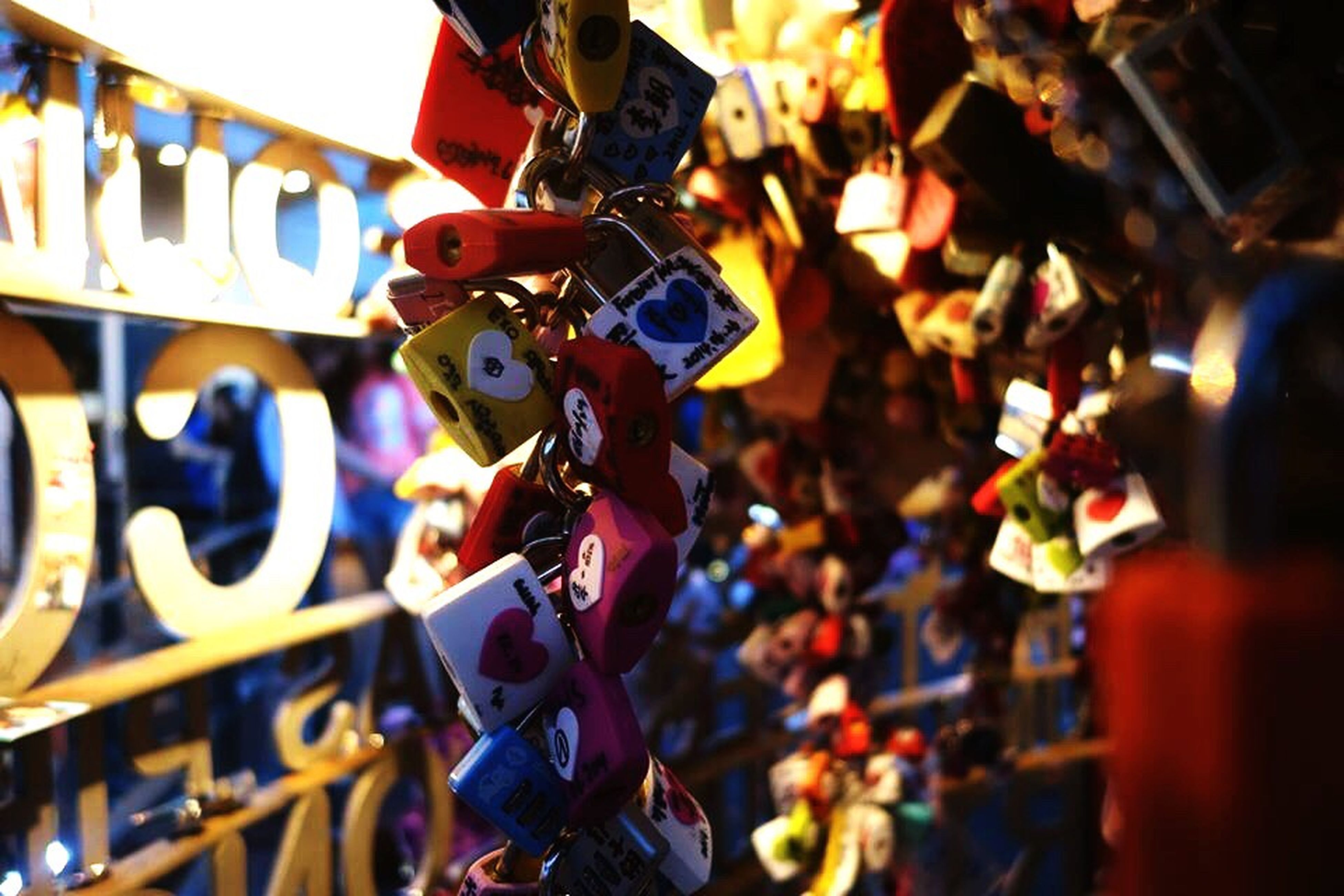 hanging, multi colored, focus on foreground, low angle view, illuminated, selective focus, lighting equipment, cultures, abundance, tradition, close-up, celebration, large group of objects, decoration, outdoors, padlock, in a row, tree, variation, lantern