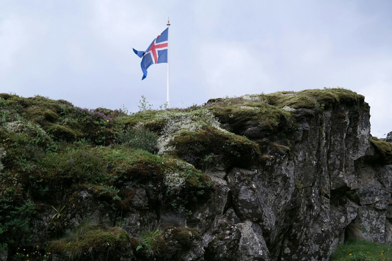 Low Angle View Of Icelandic Flag Against Sky