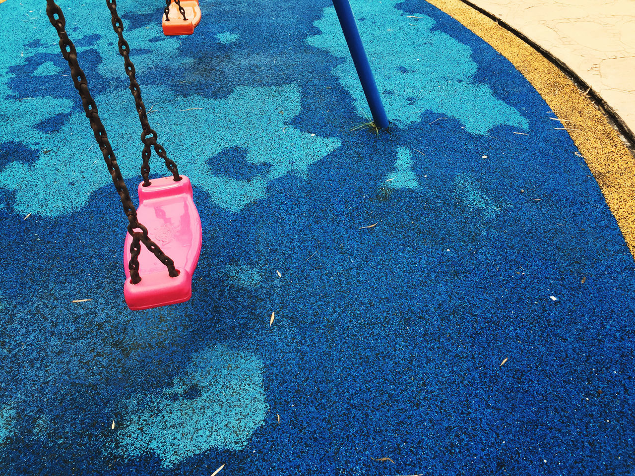 Blue Close-up Day Equipment Flooring Funtime High Angle View Holidays Kids No People Outdoor Outdoors Playground Playgrounds Recreation  Red Swing Vacation