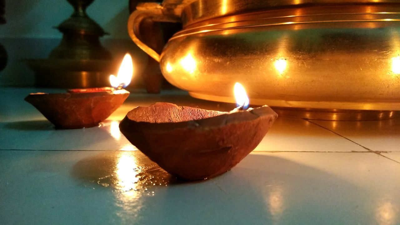 flame, glowing, burning, illuminated, candle, heat - temperature, lighting equipment, indoors, oil lamp, cultures, no people, close-up, diya - oil lamp, celebration, night