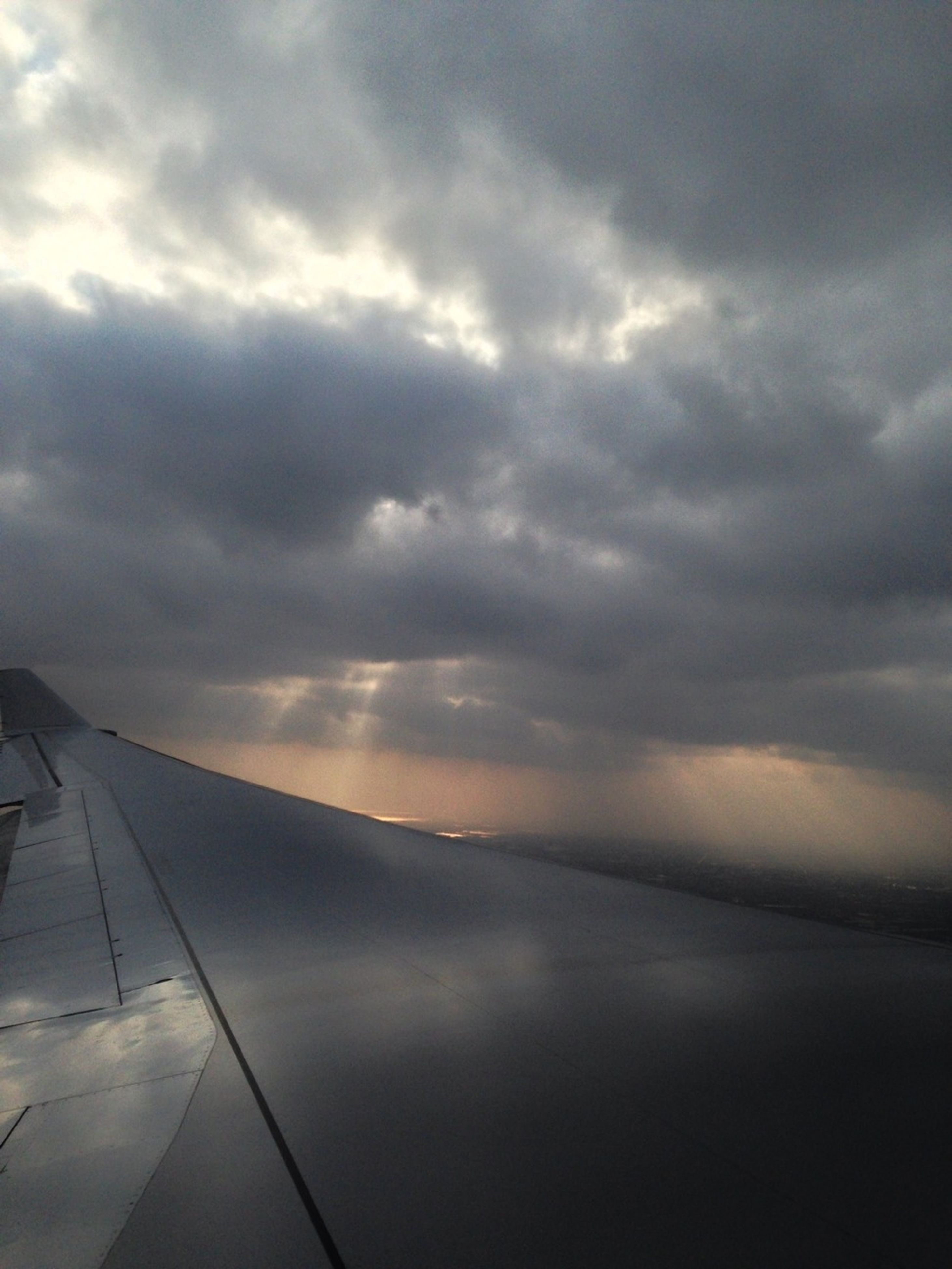 sky, cloud - sky, cloudy, weather, scenics, beauty in nature, tranquility, cloud, tranquil scene, nature, cloudscape, transportation, overcast, aerial view, outdoors, airplane, no people, day, sea, landscape