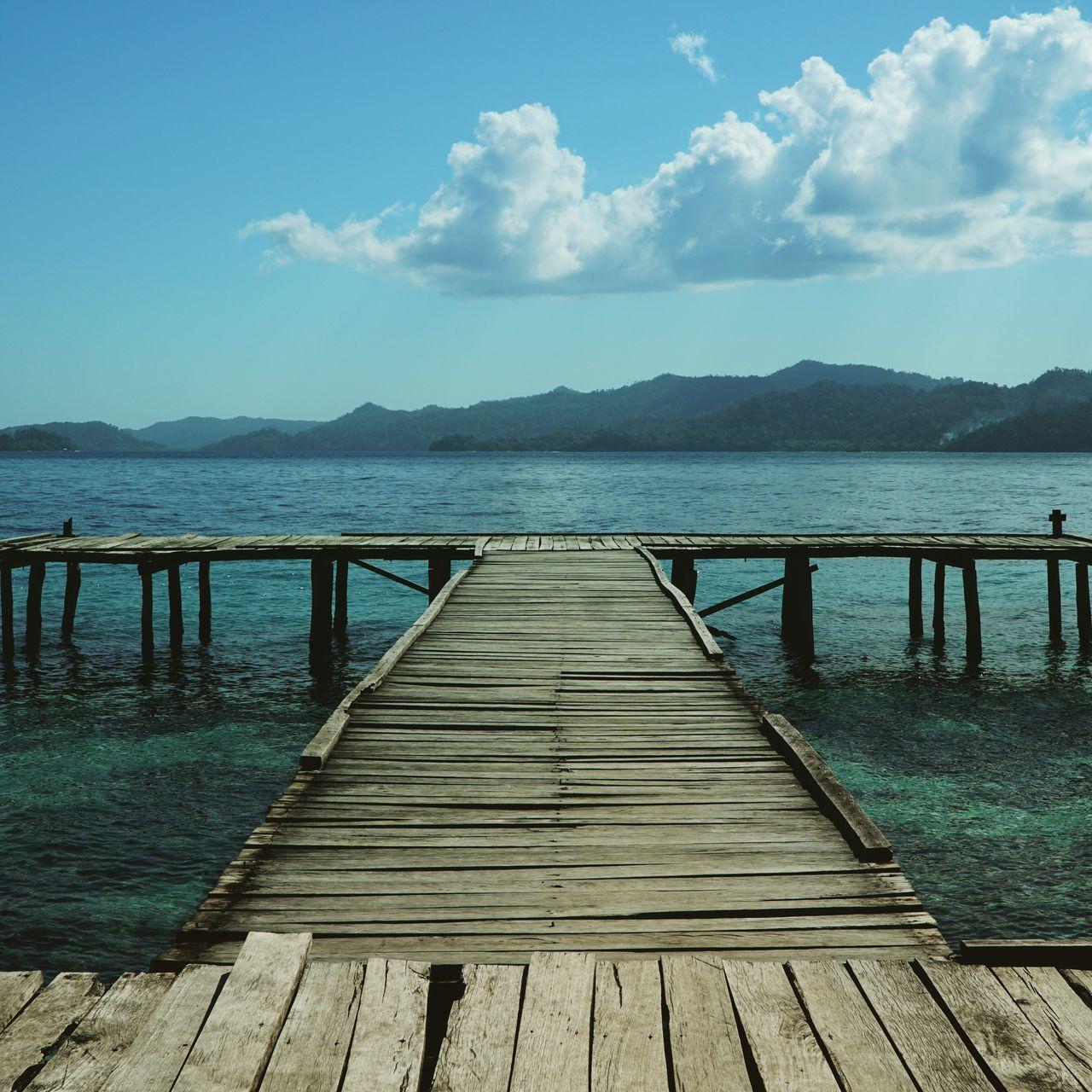 Bridge to paradise Hello World Landscape Sea Papou Blue Sky Blue Sea Deck Rajaampat Waigeo Island