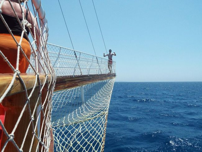 Unknown Person Bowsprit Ropes On A Boat Boat Trip Mediterranean Sea Sea Blue Water Blue Sky Blue Wave Tourist Attraction  Day Trip Tourism Travel Destinations Travel Photography Boat People Rope Ladder On The Way